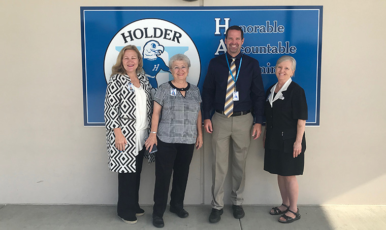 Board Members and Dr. Johnson at Holder wall