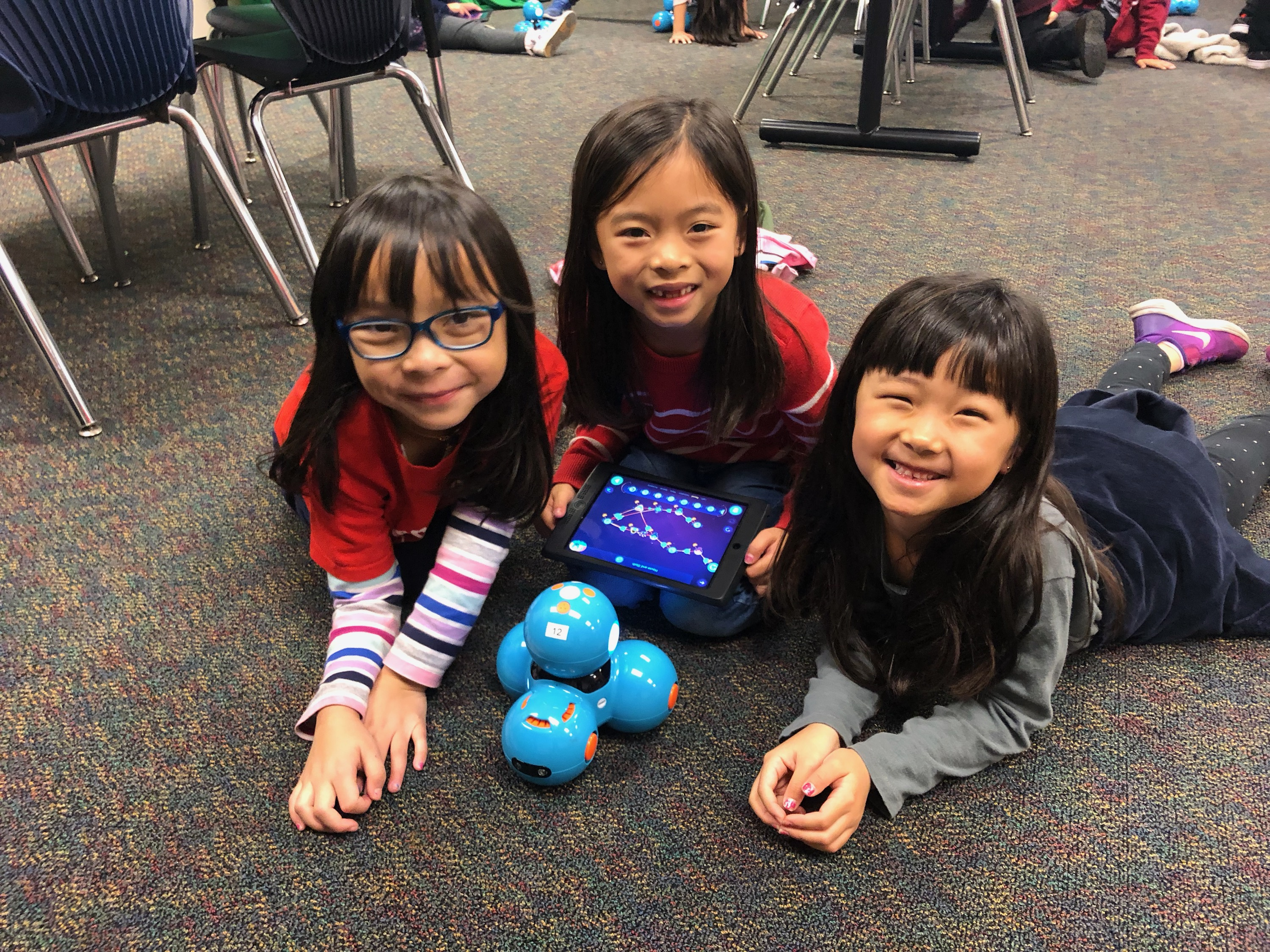 girls with dash and dot robot